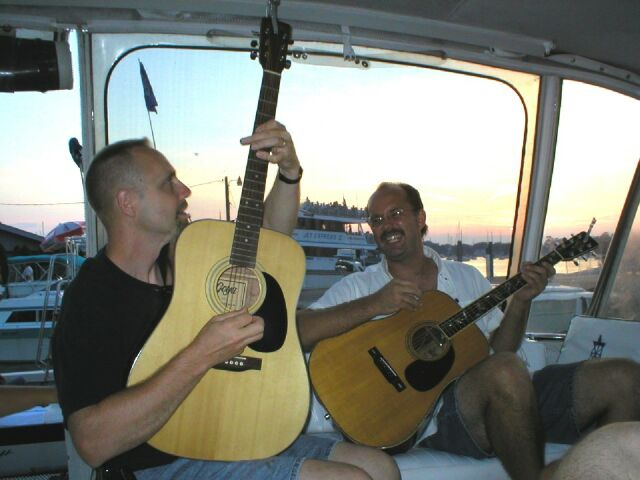"Lorne & Cody playing and singing on the boat ""Island Time"" at Put In Bay, OH, August, 2002"