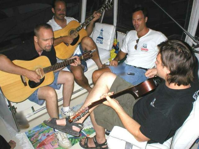 "Lorne, Cody, Mark playing and singing on the boat ""Island Time"" at Put In Bay, OH, August, 2002"