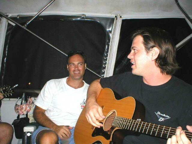 "Mark and Dave playing and singing on the boat ""Island Time"" at Put In Bay, OH, August, 2002"